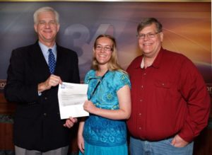 Tabitha Croft, daughter of WTVQ-TV Lexington Production Tech John Croft, is pictured receiving her $1,500 Kentucky Broadcaster's Association scholarship award from WTVQ-TV General Manager Chris Aldridge. Tabitha plans to attend Murray State University this fall and major in a pre-veterinary medicine program.