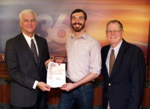 John Combs, son of Craig Combs, Account Executive at WTVQ-TV Lexington, is pictured receiving his $1,500 scholarship from WTVQ-TV General Manager Chris Aldridge. John will be attending the University of Cincinnati's College Conservatory of Music where he will be pursuing a Masters of Fine Arts in Music Theory.